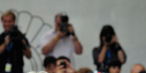 Eyewear, Vision care, Sunglasses, Coat, Camera, Video camera, Blazer, Street fashion, Journalist, Videographer,