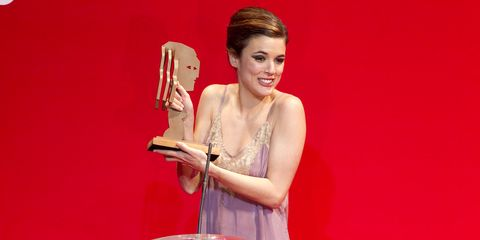 Dress, Award, Trophy, Lipstick, Cocktail dress, Day dress, Makeover, One-piece garment, Award ceremony,