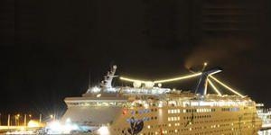 Mode of transport, Yellow, Transport, Night, Passenger ship, Watercraft, Boat, Text, Photograph, Cruise ship,