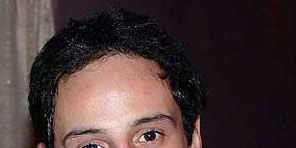 Lip, Cheek, Jacket, Hairstyle, Collar, Chin, Forehead, Eyebrow, Outerwear, Black hair,