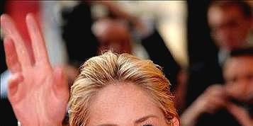 Lip, Finger, Hairstyle, Eyebrow, Facial expression, Style, Wrist, Fashion, Strapless dress, Blond,