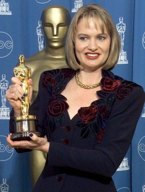 Award, Blond, Trophy, Award ceremony, Liqueur, Electric blue, Flooring, Distilled beverage,