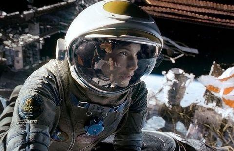 Helmet, Astronaut, Personal protective equipment, Space, Selfie, Photography, Headgear, Vehicle, Motorcycle helmet, Earth,