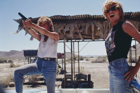 Denim, Jeans, Musician, Shooting, Shotgun, Shooting sport, Air gun, Sunglasses, Gunfighter, Trigger,