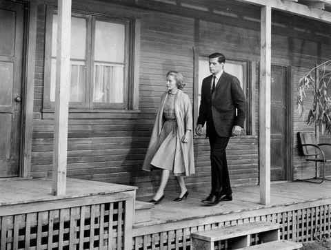 Trousers, Photograph, Standing, Monochrome, Coat, Suit trousers, Style, Suit, Blazer, Door,