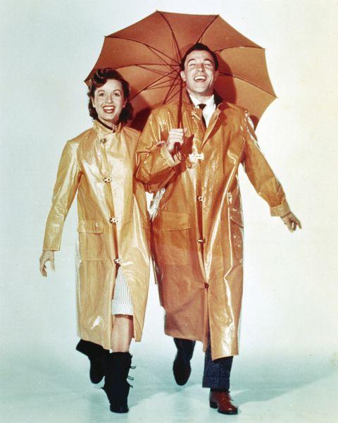 Human, Umbrella, Sleeve, Human body, Collar, Costume design, Fashion, Beige, Fashion model, Drama,