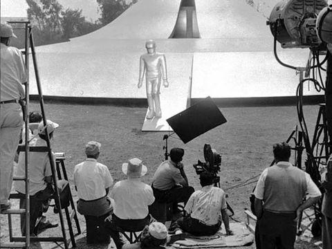 Human body, Monochrome, Camera accessory, Umbrella, Monochrome photography, Cameras & optics, Ladder, Optical instrument, Vintage clothing, Camera,