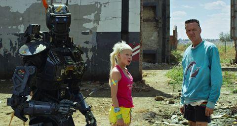 Fictional character, Machine, Video camera, Mecha, Costume, Robot, Videographer, Camera, Camera operator, Bermuda shorts,