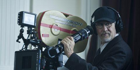 Cap, Camera accessory, Cameras & optics, Beard, Facial hair, Job, Filmmaking, Machine, Photography, Camera operator,