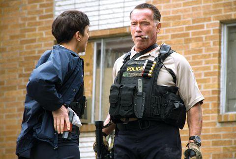 Police, Police officer, Uniform, Law enforcement, Ballistic vest, Security, Official, Belt, Brick, Bag,