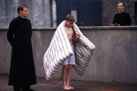 People, Human body, Temple, Barefoot, Foot, Scene, Overcoat, One-piece garment, Acting,