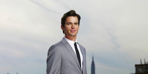 Coat, Dress shirt, Collar, Sleeve, Shirt, Suit, Standing, Photograph, Outerwear, Formal wear,