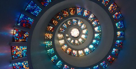 Glass, Colorfulness, Light, Interior design, Fixture, Art, Stained glass, Circle, Symmetry,