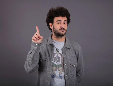 Finger, Standing, Facial hair, Gesture, Sweater, Cool, Thumb, Beard, Moustache, Jheri curl,