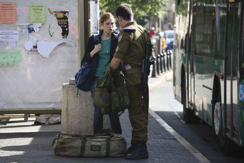 Shoe, Bag, Bus, Luggage and bags, Uniform, Military uniform, Travel, Khaki, Cargo pants, Street fashion,