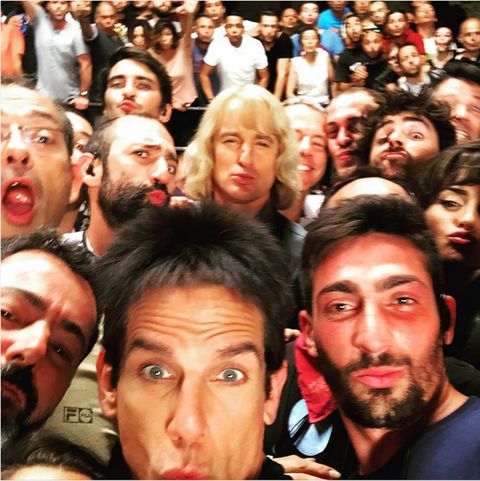 Face, Hair, Head, Nose, Mouth, Crowd, People, Eye, Hairstyle, Facial hair,