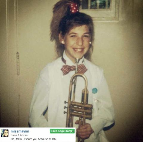 Hairstyle, Collar, Uniform, Wind instrument, Costume accessory, Brass instrument, Trophy, Costume, Woodwind instrument, Tie,