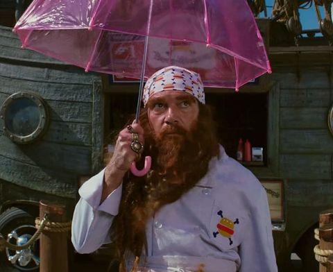 Facial hair, Umbrella, Moustache, Beard, Wind instrument, Wall clock,