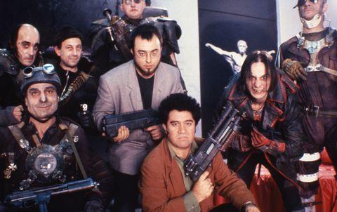 Face, Gun, Firearm, Shooting, Team, Air gun, Shotgun, Costume, Machine gun, Crew,