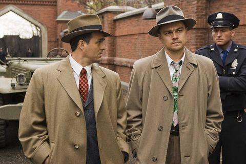Uniform, Headgear, Suit, Hat, Outerwear, White-collar worker, Fashion accessory, Gesture, Military uniform,