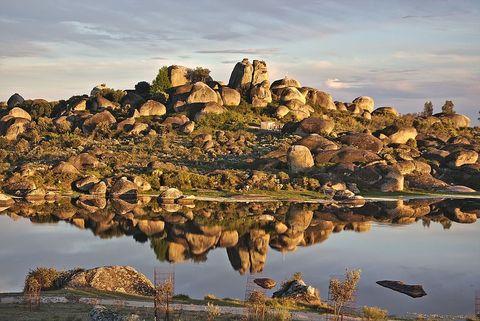 Natural landscape, Rock, Landscape, Reflection, Bedrock, Bank, Geology, Lake, Formation, Outcrop,