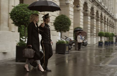 Clothing, Leg, Trousers, Outerwear, Bag, Umbrella, Coat, Urban area, Street, Street fashion,