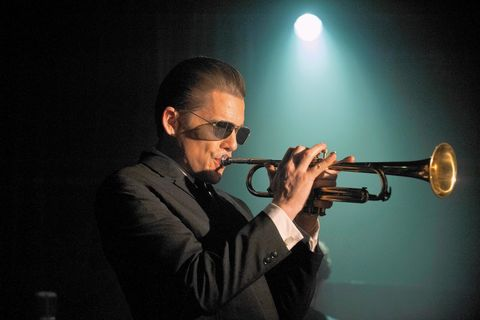 Musical instrument, Musician, Music, Entertainment, Wind instrument, Brass instrument, Music artist, Coat, Performing arts, Trumpeter,