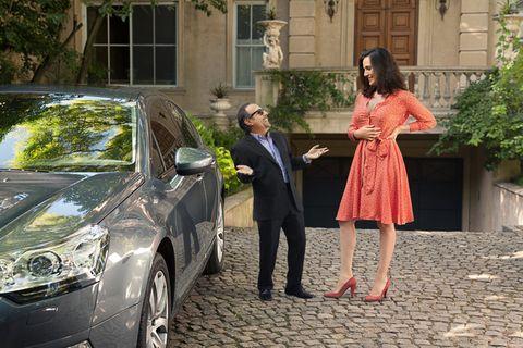 Automotive design, Vehicle, Trousers, Coat, Dress, Outerwear, Suit, Car, Alloy wheel, Formal wear,
