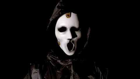Darkness, Mask, Tooth, Fictional character, Fiction, Masque, Costume, Bone,