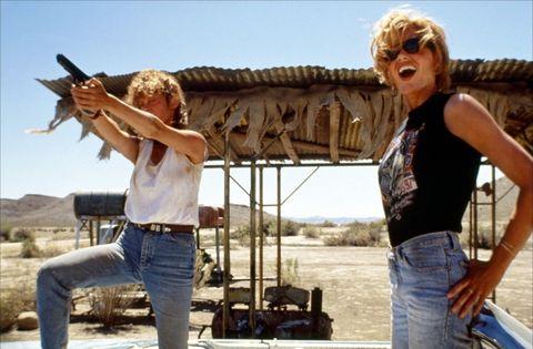 Denim, Jeans, Sunglasses, Waist, Blond, Shotgun, Belt, String instrument, Abdomen, Outdoor table,