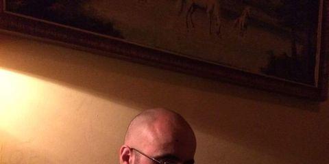 Eyewear, Glasses, Vision care, Sitting, Facial hair, Beard, Picture frame, Lap,