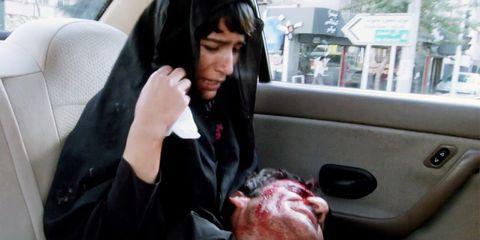 Vehicle door, Jaw, Black hair, Car seat, Automotive window part, Gesture, Thumb, Service, Head restraint, Flesh,