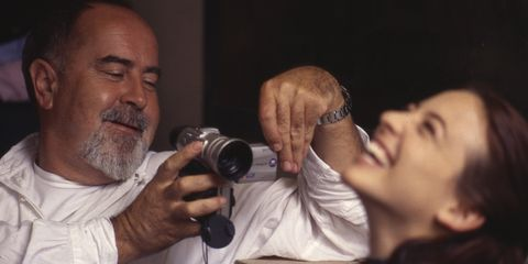 Head, Hand, Mammal, Facial hair, Beard, Wrist, Moustache, Single-lens reflex camera, Photographer, Nail,