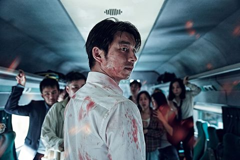 Jaw, Zombie, Black hair, Temple, Passenger, Tie, Public transport, Scar, Flesh,