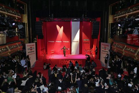 Stage, Stage equipment, Crowd, Audience, Logo, Music venue, Theatre, Hall, Display device, Convention,