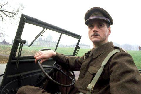 Motor vehicle, Soldier, Steering part, Steering wheel, Cap, Windscreen wiper, Glass, Military person, Vehicle door, Windshield,