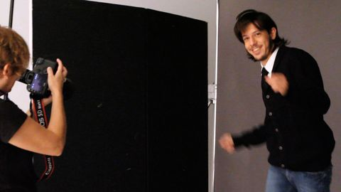 Arm, Camera, Standing, Denim, Elbow, Single-lens reflex camera, Wrist, Blackboard, Sweater, Reflex camera,