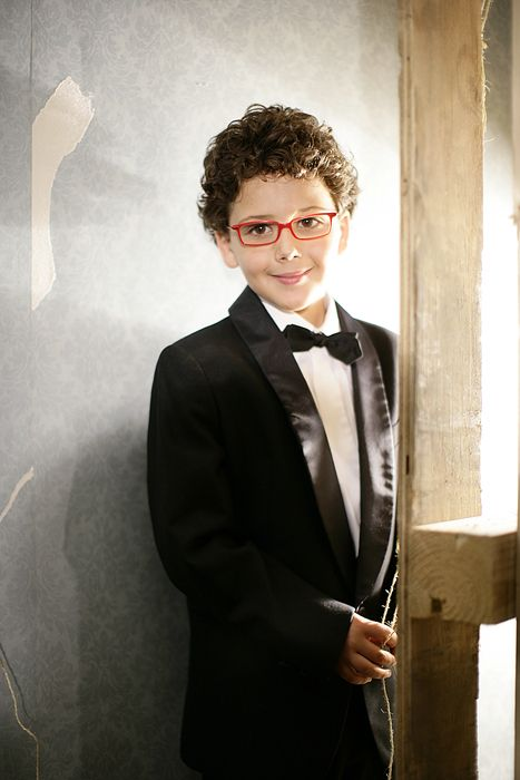 Clothing, Glasses, Coat, Collar, Dress shirt, Standing, Suit, Outerwear, Formal wear, Style,