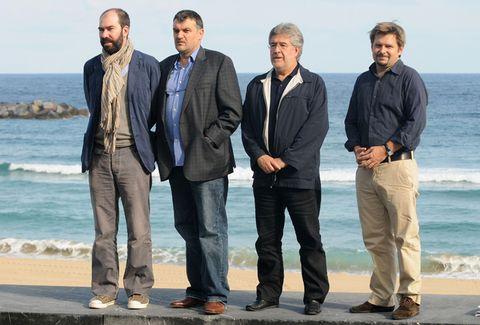 Trousers, Coastal and oceanic landforms, Standing, Ocean, Denim, Jacket, People in nature, Coast, Beach, Shore,