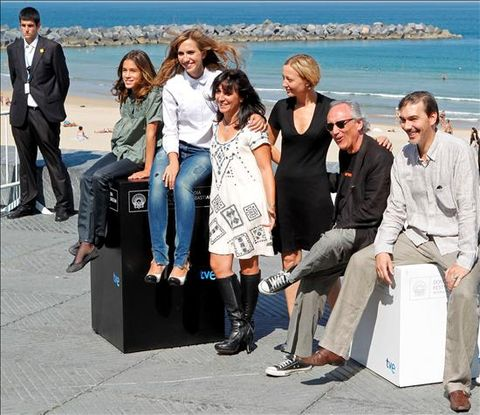 Clothing, Footwear, Leg, Trousers, Coat, Tourism, Outerwear, Ocean, Coastal and oceanic landforms, Jacket,