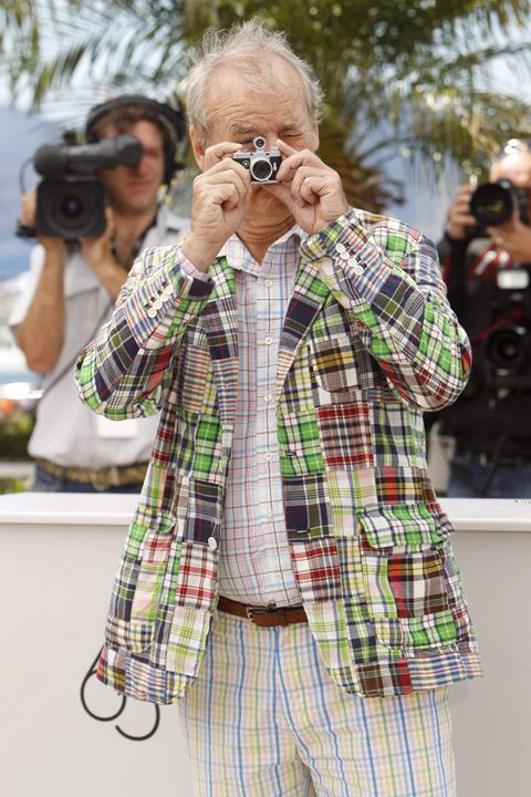 Single-lens reflex camera, Photographer, Camera, Digital camera, Cameras & optics, Lens, Dress shirt, Sleeve, Plaid, Tartan,