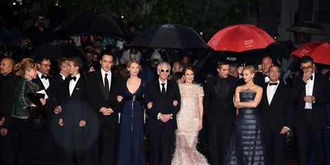 Coat, Trousers, Flooring, Umbrella, Outerwear, Suit, Formal wear, Dress, Carpet, Premiere,