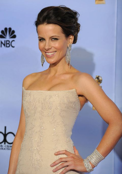 Clothing, Hair, Arm, Hairstyle, Dress, Shoulder, Strapless dress, Joint, Style, Eyelash,