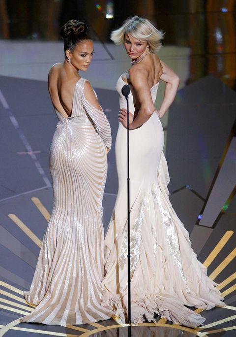Nose, Dress, Shoulder, Gown, Formal wear, One-piece garment, Fashion accessory, Beauty, Fashion, Fashion model,