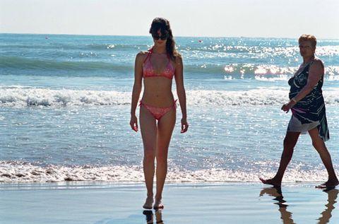 Clothing, Fun, Human body, Water, People on beach, Brassiere, Summer, People in nature, Waist, Swimwear,