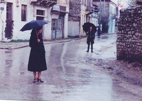 Street, Umbrella, Purple, Street fashion, Walking, Precipitation, Rain, Pedestrian, Sidewalk, One-piece garment,