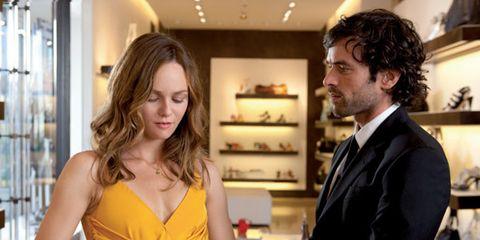 Suit, Interior design, Sitting, Shelf, Interior design, Tie, Picture frame, Conversation, Brown hair, Blond,