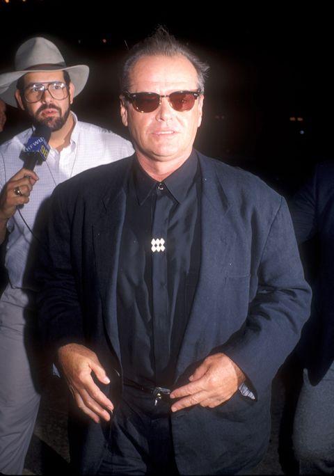 Eyewear, Glasses, Vision care, Dress shirt, Hat, Collar, Sleeve, Sunglasses, Shirt, Hand,