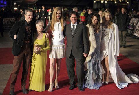 Event, Trousers, Flooring, Coat, Dress, Formal wear, Style, Carpet, Suit, Fashion,