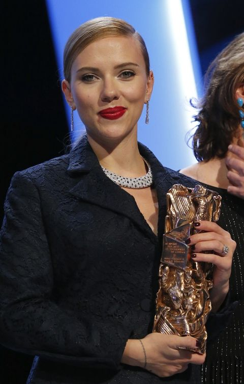 Hairstyle, Hand, Eyelash, Jewellery, Blazer, Trophy, Award, Blond, Earrings, Body jewelry,